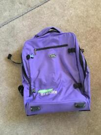 Purple hand luggage suitcase