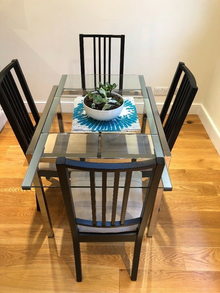 Ikea extendable glass dining table and 4 chairs