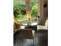 Next Glass dining table and white chairs