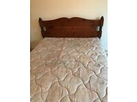 Wooden bed, 4ft 6in double, hand carved.
