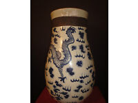 A large Chinese crackleware vase painted in underglaze blue with dragons.Approximately 44cm