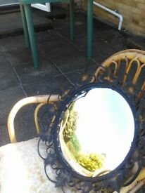 Antique wrought iron convex mirror. Black with black and gold ironwork. 18 ins diag. Ex. Cond.