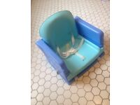 Booster seat for dining table.