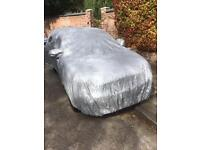 Car cover in silver, suitable for small to medium size cars