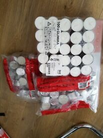 200 Tealight Candles and 58 Tealight Holders