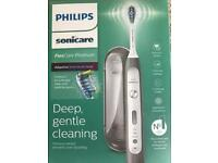 BRAND NEW Philips Electric Toothbrush