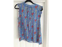 Top. Oasis. Size 12. Light blue with floral print.