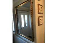 A Solid Gold Coloured Edge Mirror