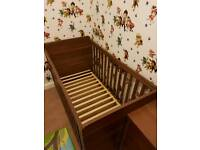 Walnut coloured cot