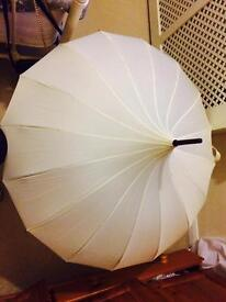 Ivory pagoda-style wedding umbrella / parasol