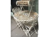 TABLE AND THREE CHAIRS ALL FOLD UP WROUGHT IRON QUITE TATTY BUT USABLE
