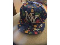 Blue snap back cap