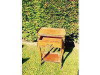 Nice antique pretty piece of furniture !edged with brass, small draw , nice legs