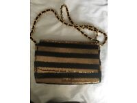 Gold and black ladies handbag