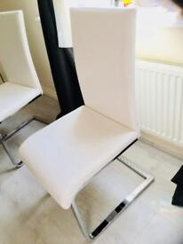 Sold / 4 white faux leather chairs
