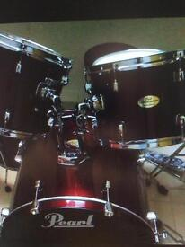 Red Pearl forum drum kit, hi hat stand, cymbal stand and throne. No bass pedal