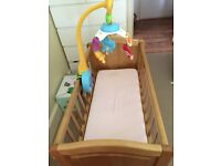 Mothercare swinging crib with mattress and fisher price musical mobile
