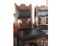 Five carved oak chairs.