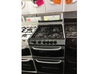 CANNON 55CM ALL GAS COOKER IN SILIVER WITH LID. W