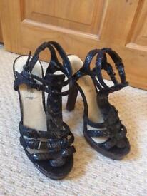 Ladies high heeled sandals