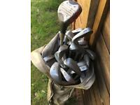 Old & new golf clubs with bag