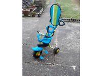 Blue Trike and ride on bike
