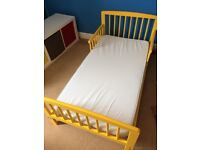Lovely bold yellow toddler bed including mattress, duvets and covers