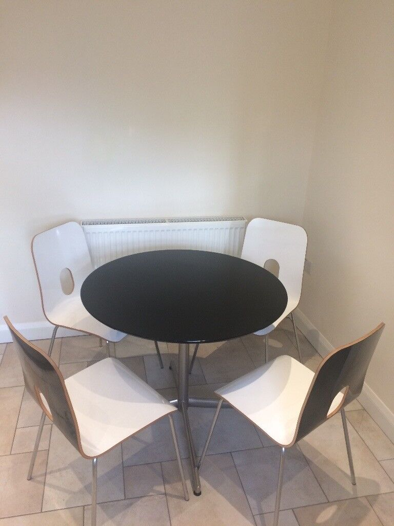 John Lewis Round Black Glass Top Table and four chairs