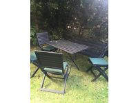 garden table, 4 chairs with cushions and bench for sale