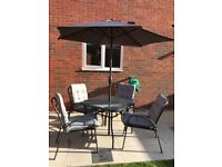 Outdoor table and 4 chairs with umbrella