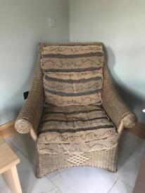 Wicker sofa, two chairs and a table