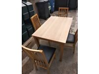 Table and 4 chairs good condition