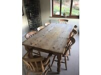 8 seater antique pine table and chairs.
