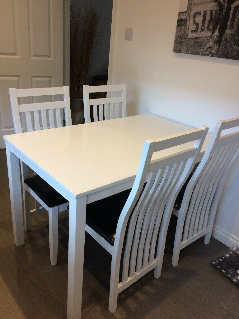 White Dining Table And 4 Chairs With Black Seat Base