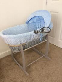 Blue Moses basket with grey stand.