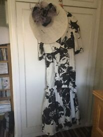 Florentyna Dawn elegant dress and hat.