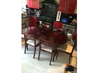mahogany dinning table and 6 chairs!! £80 ono!!!