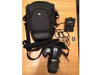 Nikon D3100 DSLR with bag and 32MB card