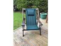 Oversized hardwood green fabric deckchair with pillow headrest. Washable.