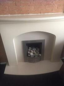 Gas fire with surround and hearth