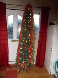 6ft slimline Christmas tree with decorations