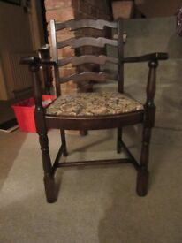Two dark wood carver chairs