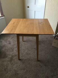 solid light wood dining table