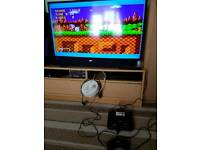 Retro Sega mega drive 2 console with controller leads and sonic the hedgehog