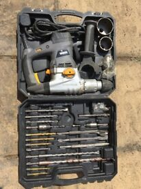 Titan SDS drill set with drill set, used once.