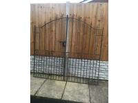 Set of tall side entrance wrought iron gates can deliver