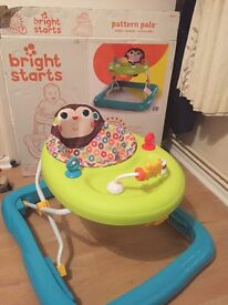 Nearly new bright starts walker