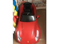 Kids battery operated Ferrari , needs a new charger but otherwise great condition