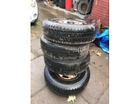 Four 215 75 16c part worn tyres on transit rims