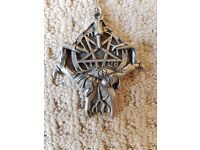 Pentagram in hand pendant with chain in great condition.